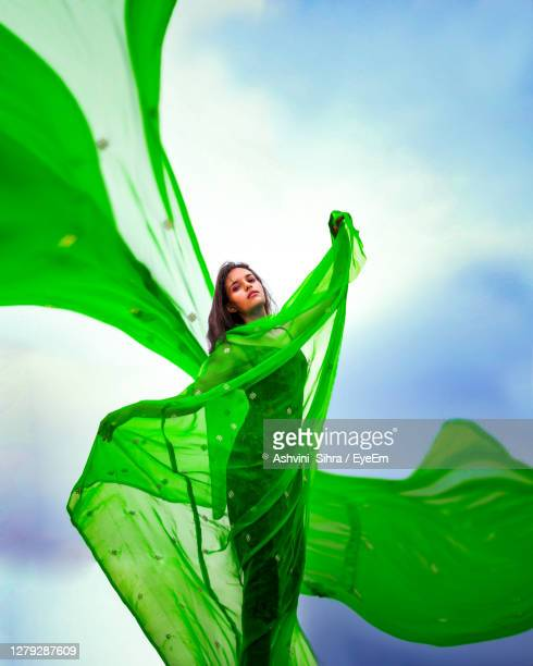 portrait of young woman with large fabric against sky - haute couture stock pictures, royalty-free photos & images