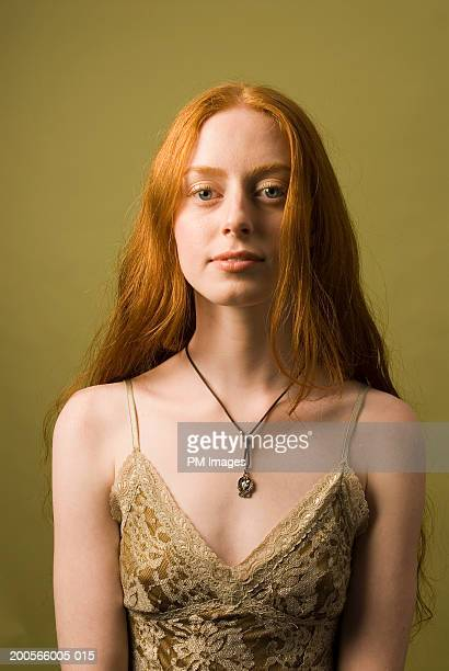 portrait of young woman with long ginger hair wearing lingerie, upper half - solo una donna giovane foto e immagini stock