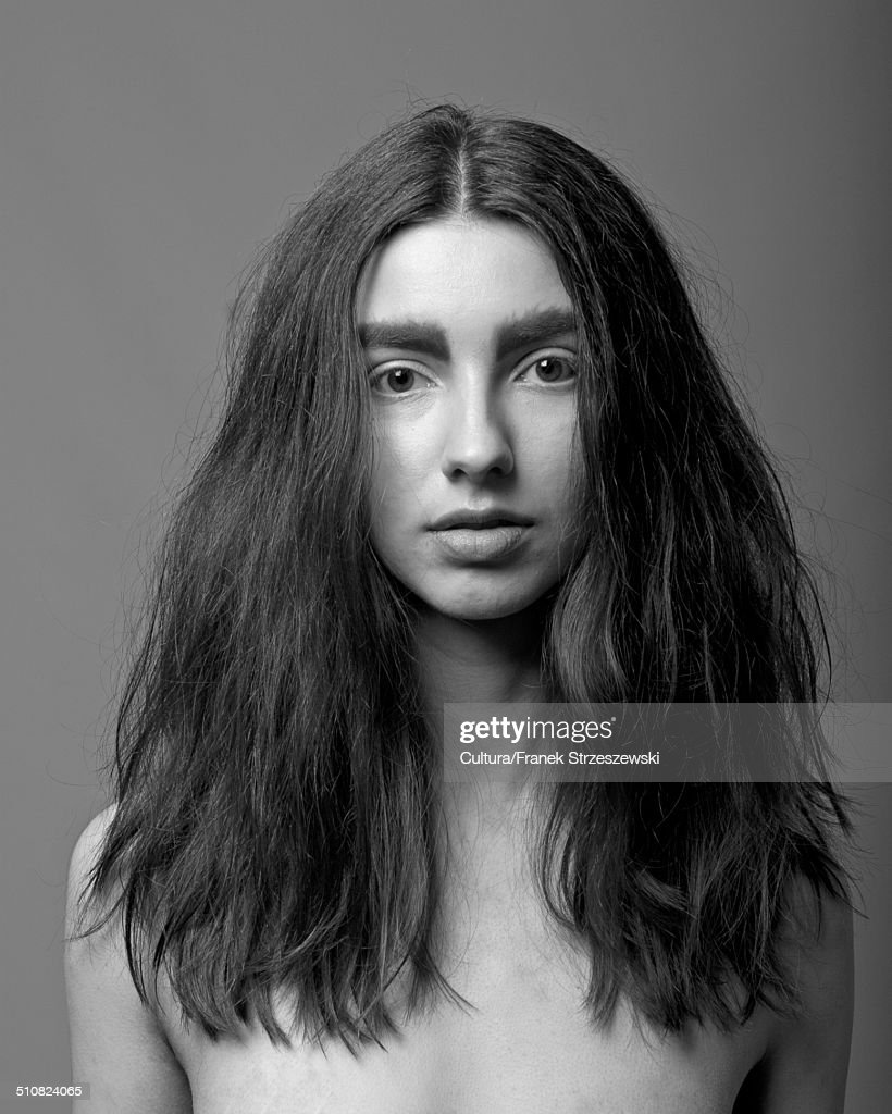 Portrait of young woman with long hair : Stock-Foto