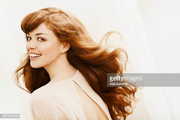 portrait of young woman with long red hair