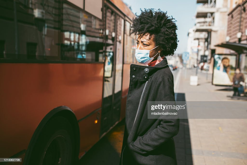 Portrait Of Young Woman With Mask On The Street. : Stock Photo