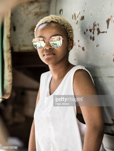 portrait of young woman with mirrored sunglasses - bleached hair stock pictures, royalty-free photos & images
