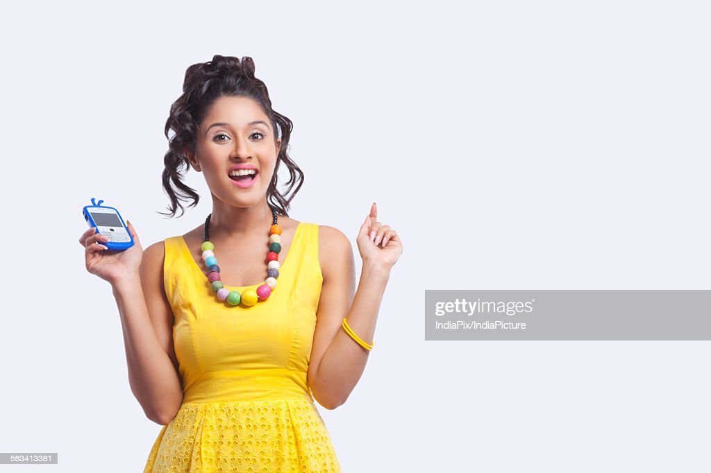 Portrait of young woman with mobile phone : Stock Photo