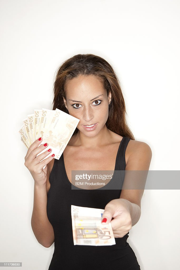 Portrait of young woman with money : Stock Photo