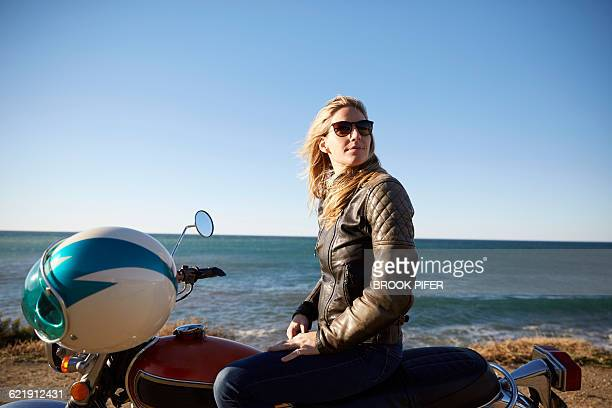 Portrait of young woman with motorcycle