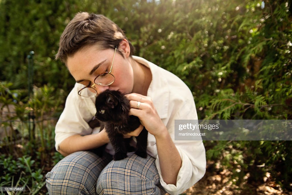 Portrait of young woman with newly adopted kitten. : Stock Photo