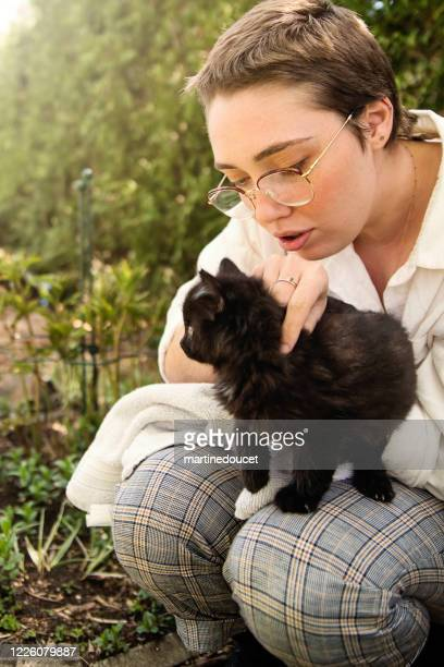 """portrait of young woman with newly adopted kitten. - """"martine doucet"""" or martinedoucet stock pictures, royalty-free photos & images"""