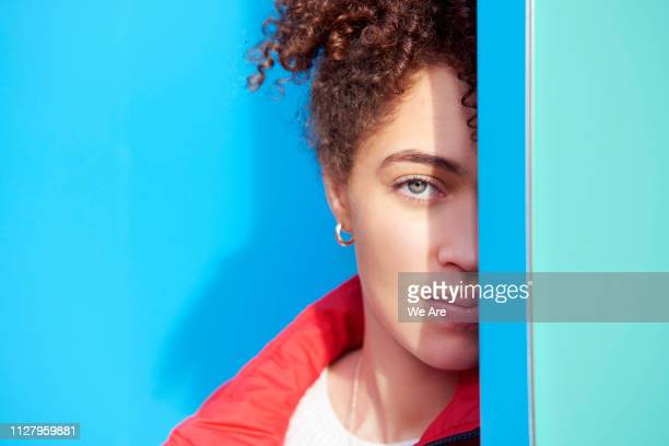 portrait of young woman with obscured face. - farbquadrat stock-fotos und bilder