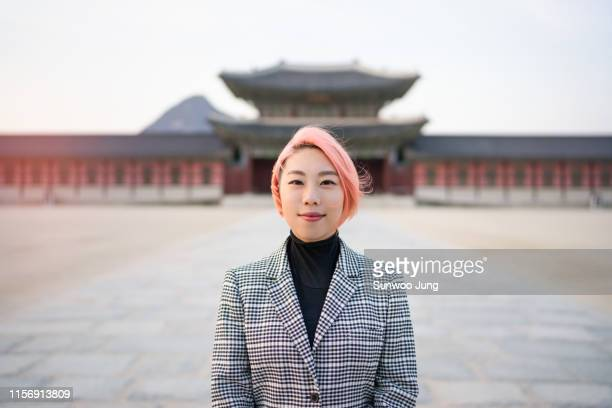 portrait of young woman with pink colored hair - korean culture stock pictures, royalty-free photos & images