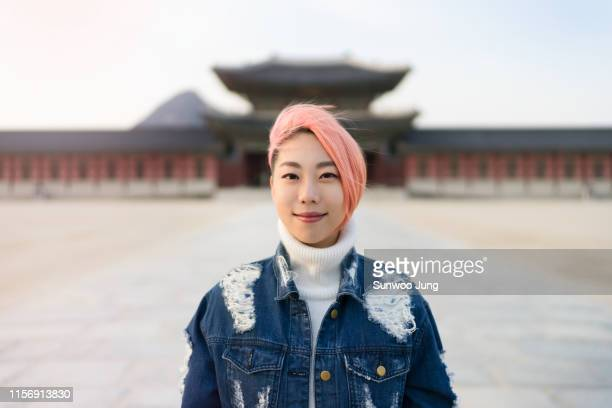portrait of young woman with pink colored hair - korea stock pictures, royalty-free photos & images