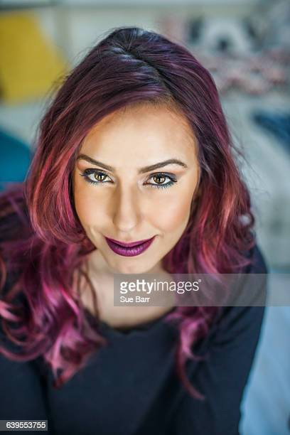 portrait of young woman with pink hair, smiling - purple hair stock photos and pictures