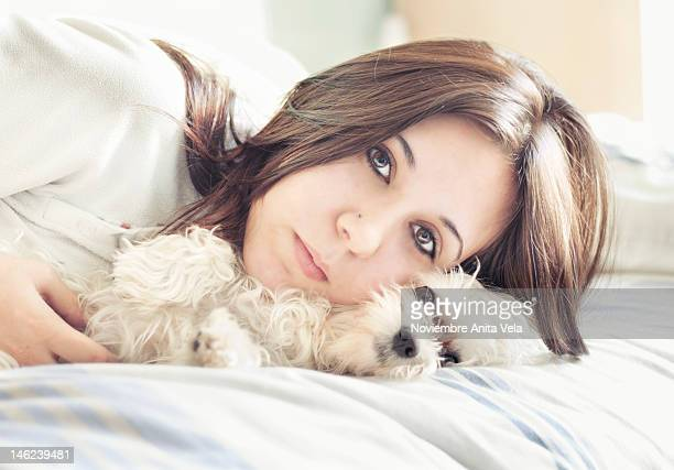 Portrait of young woman with puppy