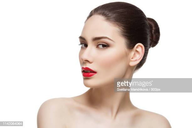 portrait of young woman with red lipstick against white background - おだんごヘア ストックフォトと画像