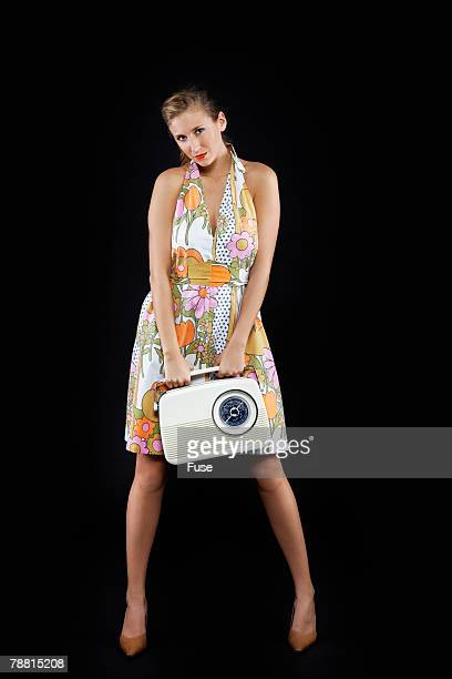 Portrait of Young Woman With Retro Radio