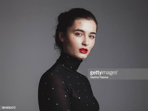 portrait of young woman with rhinestones on her face and top - high collar stock pictures, royalty-free photos & images