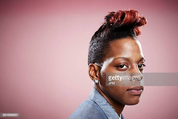 portrait of young woman with serious expression - androgynous stock pictures, royalty-free photos & images