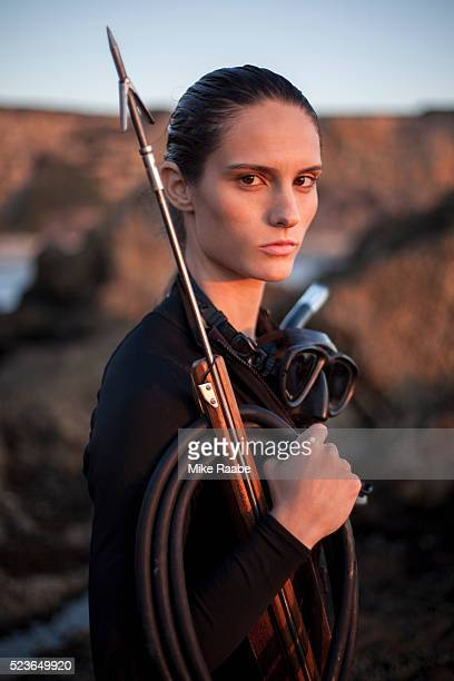 Portrait of young woman with speargun, Palos Verdes Peninsula, Los Angeles County, California, USA