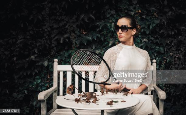 Portrait Of Young Woman With Sunglasses Against Trees