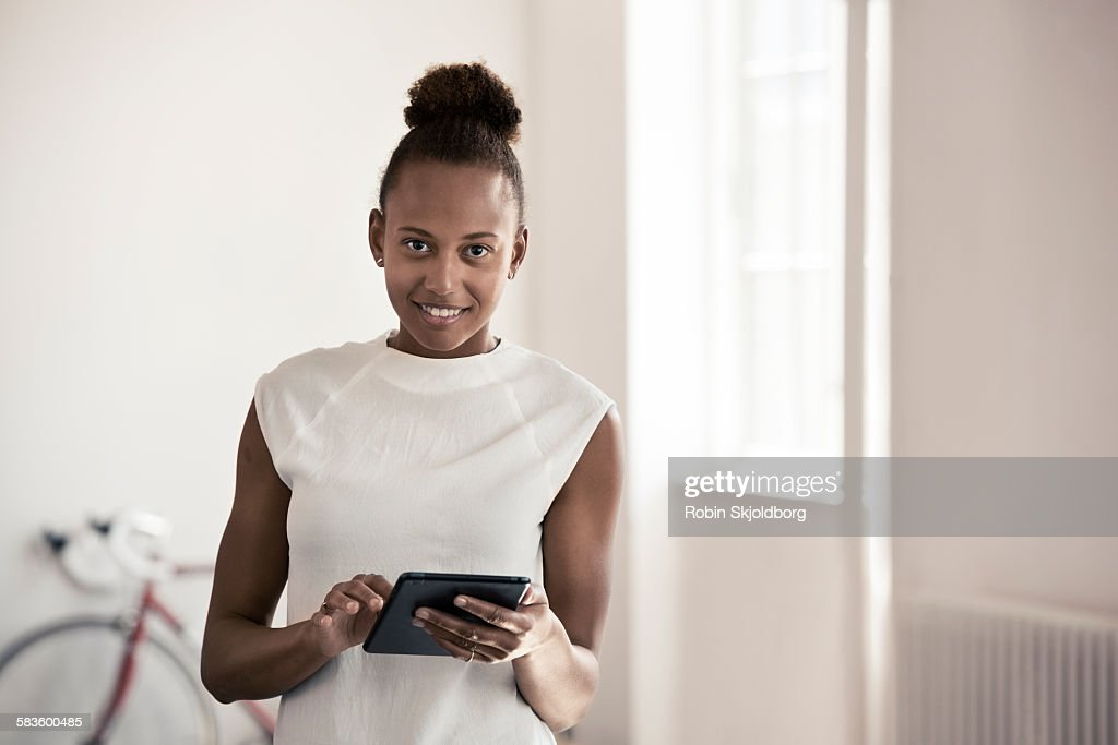 Portrait of young Woman with Ipad : Stock Photo