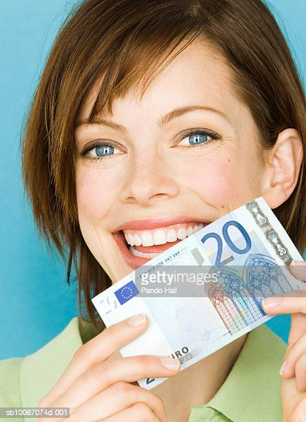 portrait of young woman with twenty euro bill - twenty euro banknote stock photos and pictures