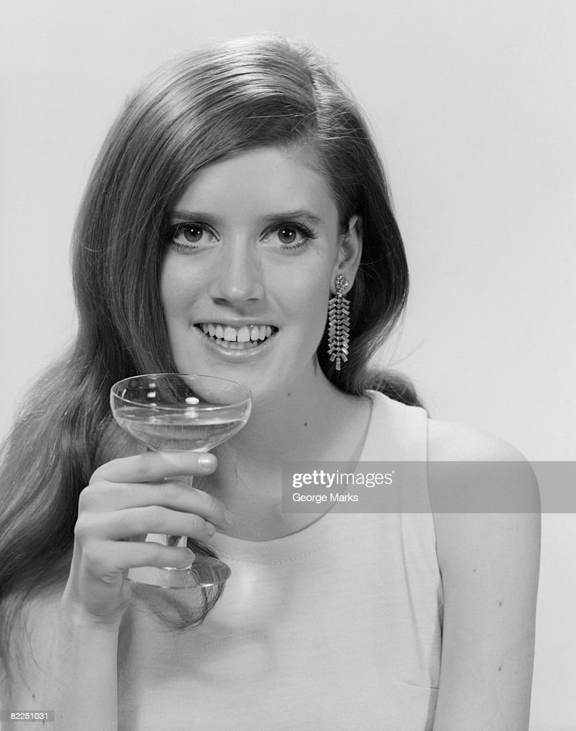 Portrait of young woman with wineglass : Stock Photo