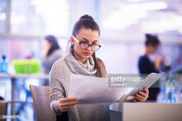 Portrait of young woman working in an office