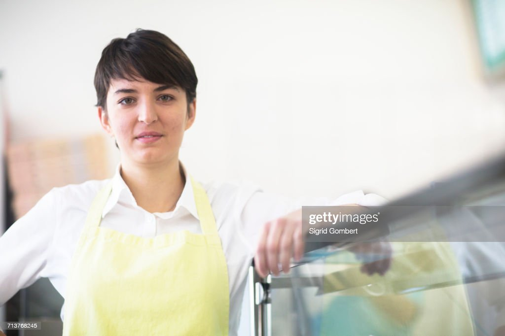 Portrait of young woman, working in fast food shop : ストックフォト