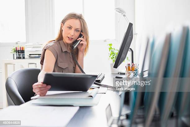 portrait of young woman working in office, jersey city, new jersey, usa - secretary stock photos and pictures