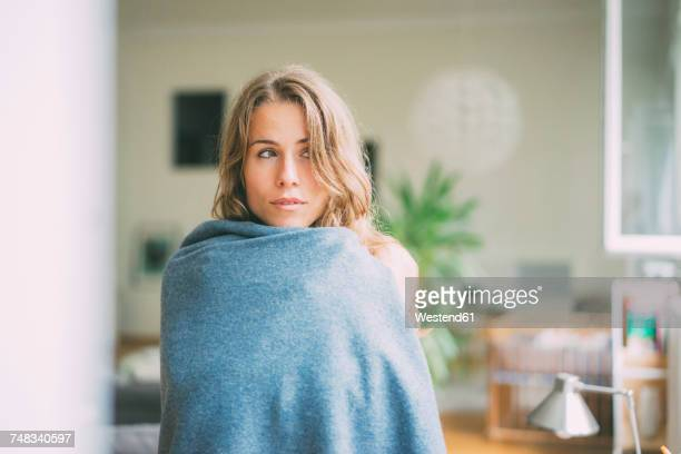 Portrait of young woman wrapped in a blanket
