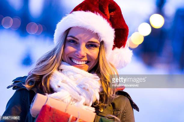Portrait of young womanwith Santa's hat