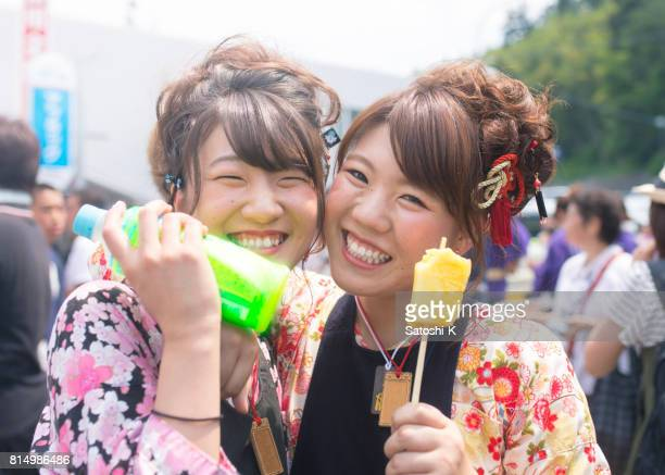 portrait of young women in traditional japanese matsuri costume - kanto region stock photos and pictures