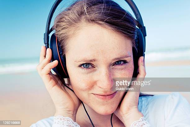 Portrait of young women listen to music