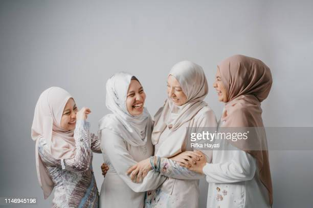 portrait of young women siblings for hari raya aidilfitri (eid al-fitr) - eid mubarak stock pictures, royalty-free photos & images