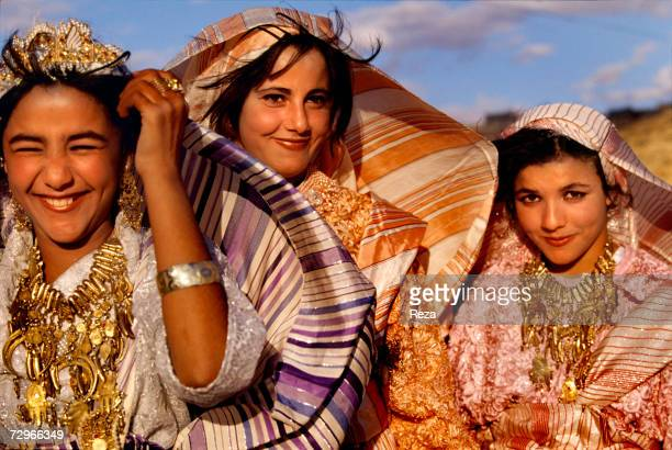 Portrait of young women wearing the traditional Berber clothing and jewelry during a folk festival on April 2000 in Kabaw Libya