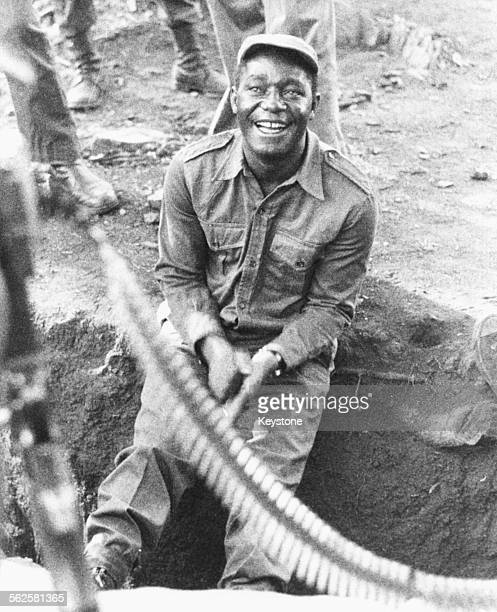 Portrait of Zimbabwe Cabinet Minister Edgar Tekere sitting in a dug out wearing army uniform pictured following his murder charge in November 26th...