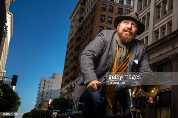 portrait on bearded man riding bike - cravat stock pictures, royalty-free photos & images