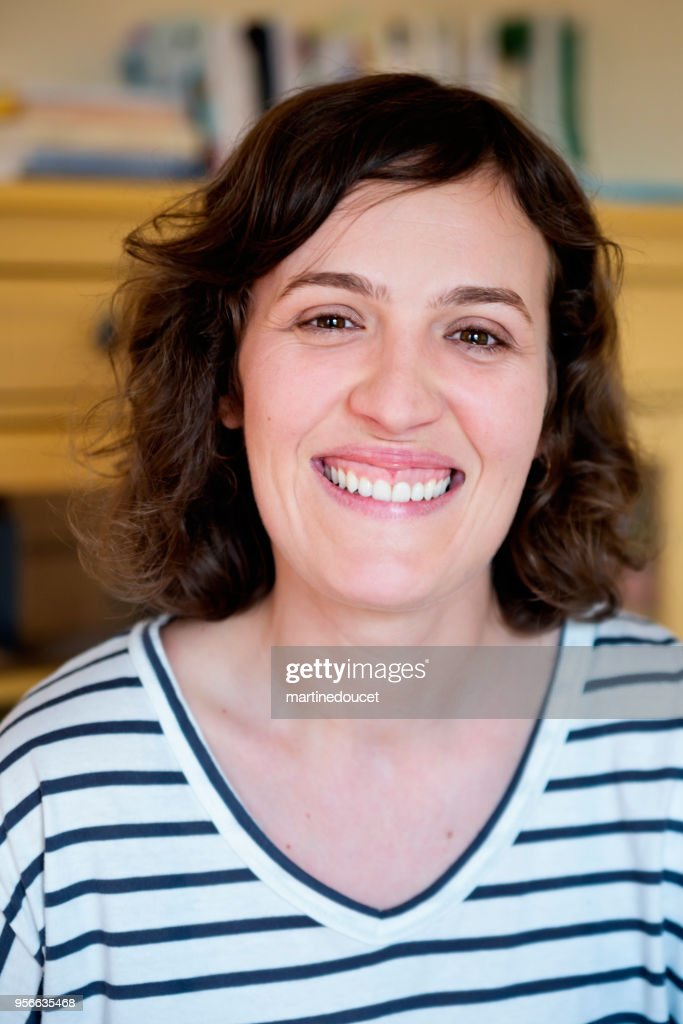 Portrait on woman in late thirties at home. : Stock Photo