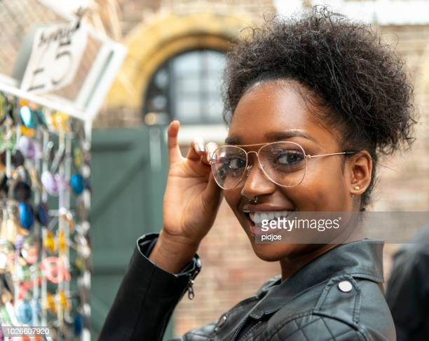 portrait outdoors of a young afro american woman with glasses. - charming stock pictures, royalty-free photos & images
