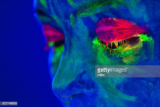 portrait painted with fluorescent makeup under the ultraviolet l - fluorescent light stock pictures, royalty-free photos & images