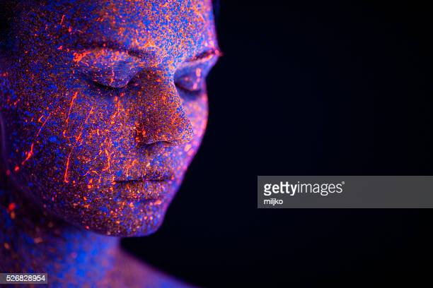 portrait painted with fluorescent makeup under the ultraviolet l - body paint stock pictures, royalty-free photos & images