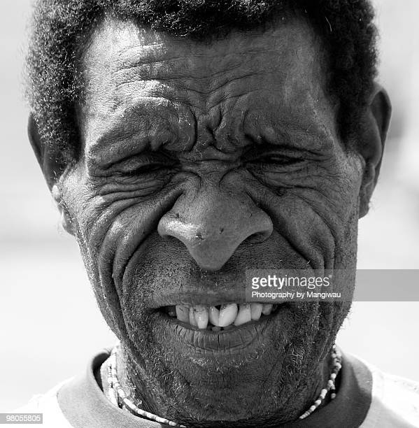 portrait papuan man - ugly man stock photos and pictures