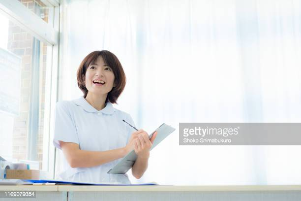 portrait photo of nurse in the room. - medical procedure stock pictures, royalty-free photos & images