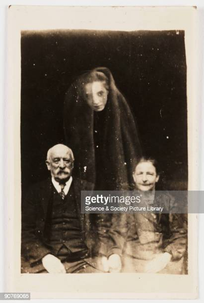 A portrait photograph possibly taken by William Hope A young woman's face appears as if floating above the sitters draped in a cloak Hope may have...