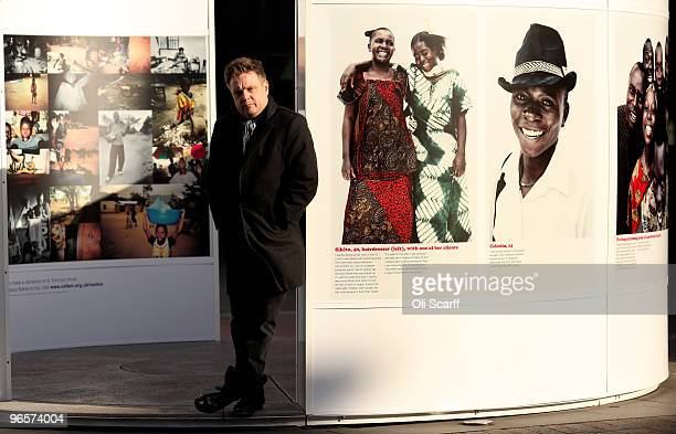 Portrait photographer Rankin poses outside the National Theatre with images he took on a recent visit to the Democratic Republic of Congo with Oxfam...