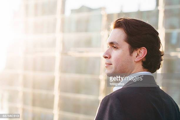 portrait: profil of confident businessman in front of modern architecture - profil stock photos and pictures