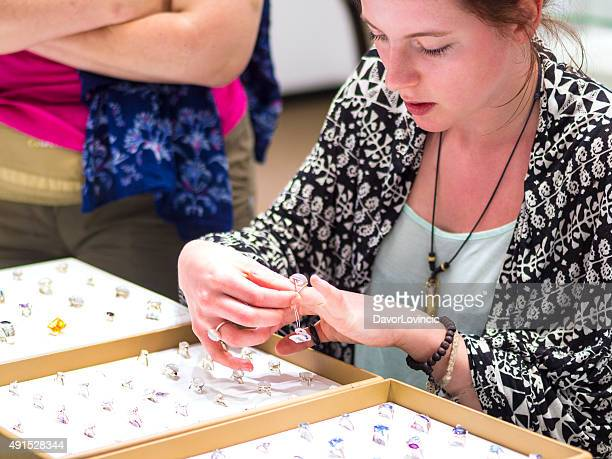 Portrait profile of young beautiful tourist looking at rings