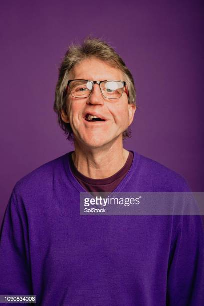portrait senior man - purple background stock photos and pictures
