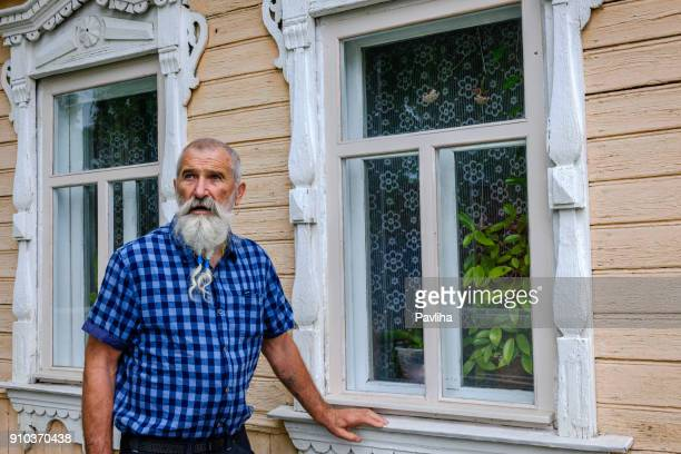 Portrait Senior Man with White Beard on a journey through the Russian rivers