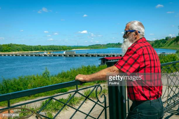 portrait senior man with white beard on a journey through the russian rivers - volga stock pictures, royalty-free photos & images