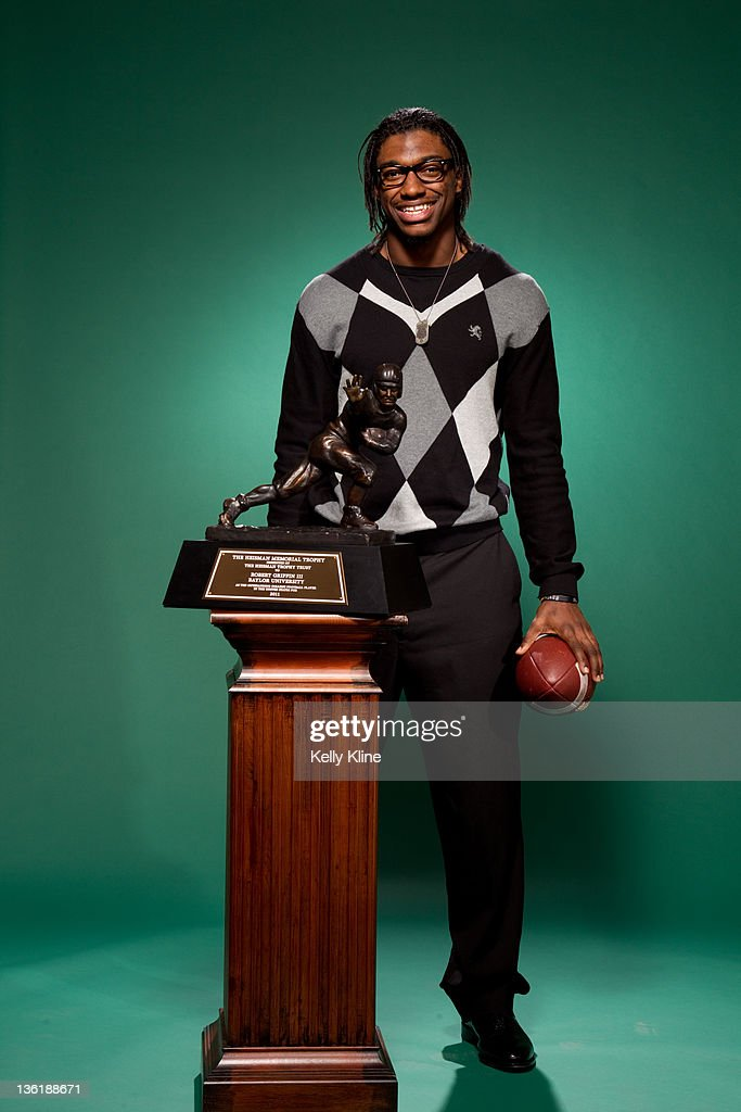 Portraits with 20011 Heisman Trophy winner Robert Griffin III of the Baylor Bears at the Marriott Marquis December 11, 2011 in New York City. NEW YORK, NY - DECEMBER 11: Portrait session with 2011 Heisman Trophy Winner Robert Griffin III of the Baylor Bears on December 11, 2011 in New York City.